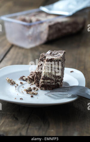 Halva with almonds and raisins on plate,  close up - Stock Photo