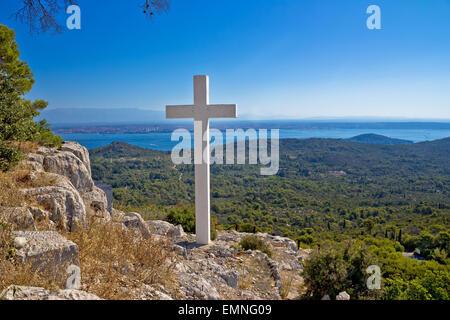 Cross overlooking islands of Croatia, top of Ugljan island in Dalmatia region - Stock Photo