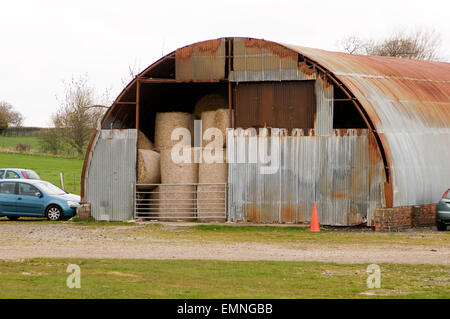 Anderson shelter air raid raids shelters temporary world war 2 two building building corrugated iron sheet sheets - Stock Photo
