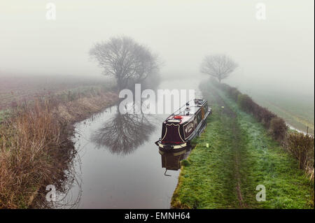 Narrowboat William moored on a misty morning - Stock Photo