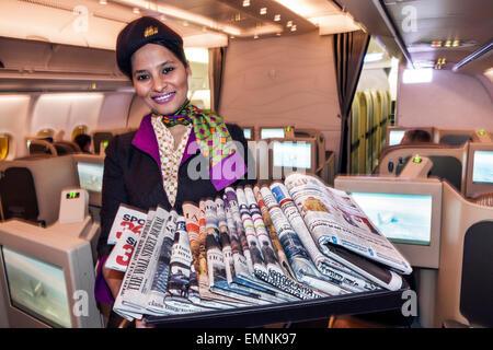 Virginia Dulles International Airport IAD terminal Etihad Airways Business Class onboard cabin Asian woman flight - Stock Photo