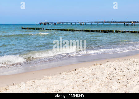 Picture of the pier of Graal Muritz with beach, sea and Baltic Sea in Germany - Stock Photo
