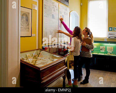 Children inside Lyme Regis Museum containing a collection of fossils found on the Jurassic Coast in West Dorset - Stock Photo