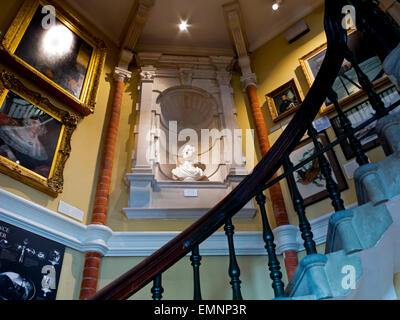 Interior view of Lyme Regis Museum containing a collection of fossils found on the Jurassic Coast in West Dorset - Stock Photo