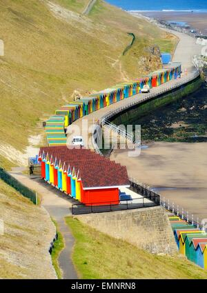 Brightly coloured beach huts on the sea front in Whitby ,North Yorkshire, England,uk - Stock Photo