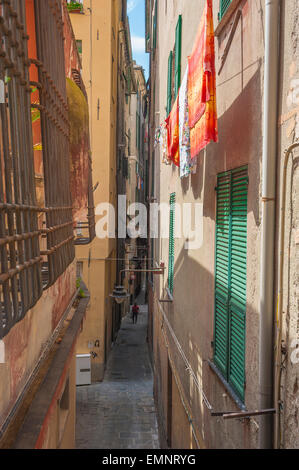 Genoa alley, a typical narrow street in the medieval center of Genova - the Centro Storico - Liguria, Italy. - Stock Photo