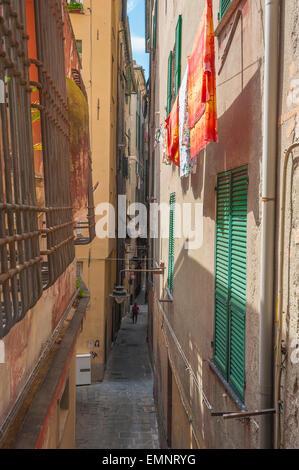 Genoa alley, a typical narrow street in the medieval center of Genova - the Centro Storico - Liguria, Italy. - Stock Photo