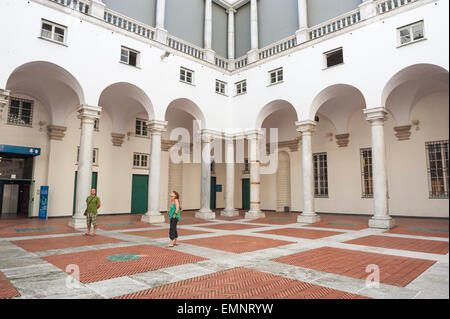 Genoa museum, tourists in the Palazzo Ducale in Genoa pause to appreciate the architecture of its courtyard, Genova, - Stock Photo