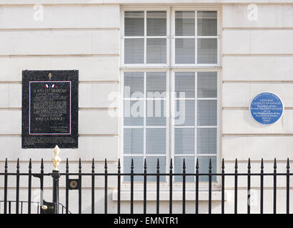 Plaques to General de Gaulle on the wall of the house in London where he resided after fleeing France when it was - Stock Photo