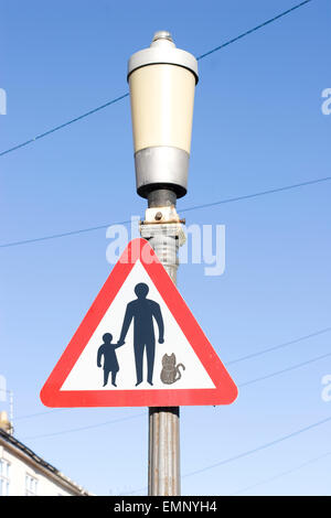 Parent and child - and cat - road sign, which warns drivers of pedestrians and cats in the road ahead, Bristol - Stock Photo