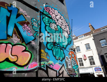 Street art off Brick Lane in Shoreditch, London Borough of Tower Hamlets, an area renown for its paintings and posters - Stock Photo