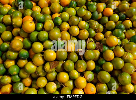 Limes (Citrus aurantiifolia) for sale at a market in Indonesia - Stock Photo