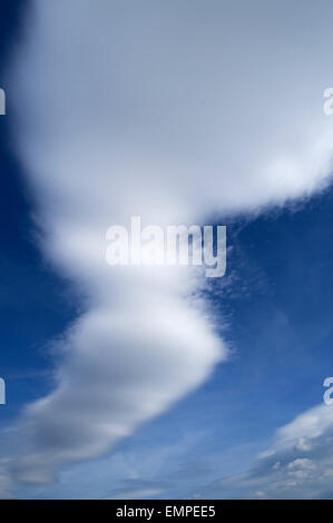 Cumulonimbus capillatus clouds in a blue sky - Stock Photo