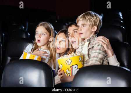 Shocked Family Watching Movie In Theater - Stock Photo
