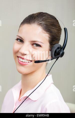 Call Center Employee With Headphones - Stock Photo