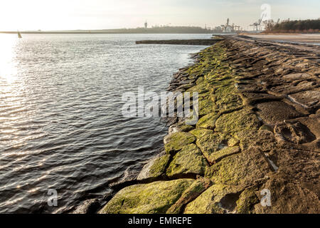 Old port embankment made of stones in Swinoujscie, Poland. - Stock Photo