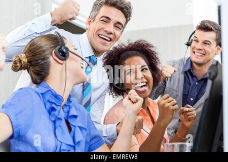 Cheerful Customer Service Representatives And Manager Celebratin - Stock Photo