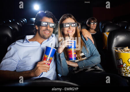 Happy Couple Watching 3D Film In Theater - Stock Photo