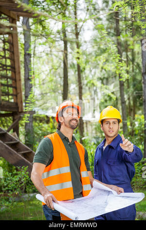 Architect Showing Something To Colleague At Construction Site - Stock Photo