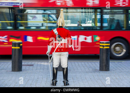 A trooper, from the Life Guards cavalry regiment, stands guard at the entrance to Hores Guards Parade on Whitehall, - Stock Photo