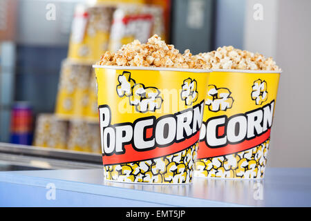 Popcorn Buckets At Concession Stand - Stock Photo