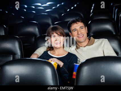 Smiling Couple Watching Film In Theater - Stock Photo