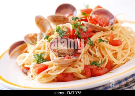 spaghetti with clams, a traditional Italian recipe - Stock Photo