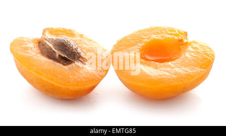 Apricot fruits - halves, isolated on white background - Stock Photo