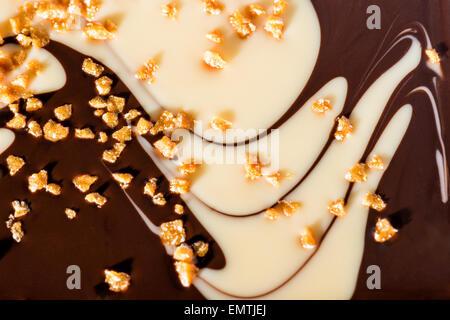 exclusive two-tone chocolate happy with caramel and white chocolate dark chocolate studio light tastes savory Still - Stock Photo