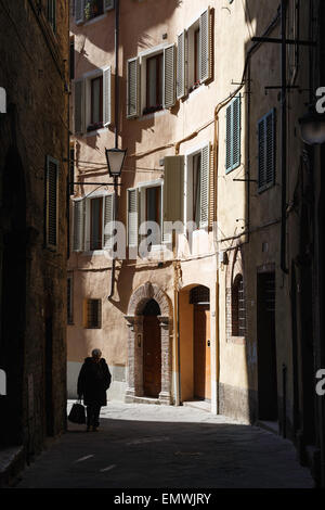 An alley in the historic center of Siena, Tuscany, Italy. - Stock Photo