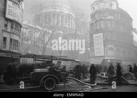 St Paul's Cathedral seen from the church yard after a night of bombing on 29th December 1940. - Stock Photo