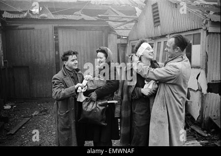 V2 Rocket incident at Brush Factory, High St, Waltham Cross. Factory girl smiling as she is bandaged up. 2nd January 1945 Stock Photo
