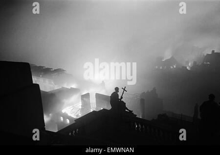 Fires raging around St Paul's Cathedral during the night of bombing on 29th December 1940. - Stock Photo