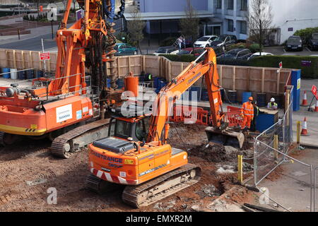 Heavy duty excavating equipment at work at a building site in Salford close to Manchester city centre. - Stock Photo