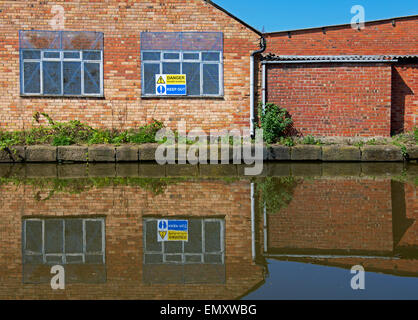 Sign warning Danger, Unsafe Building, Macclesfield Canal in Macclesfield, Cheshire, England UK - Stock Photo