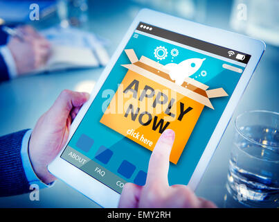 Man Using a Digital Tablet Online Application - Stock Photo