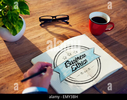 Man and Notepad with Business Ethics Concept - Stock Photo