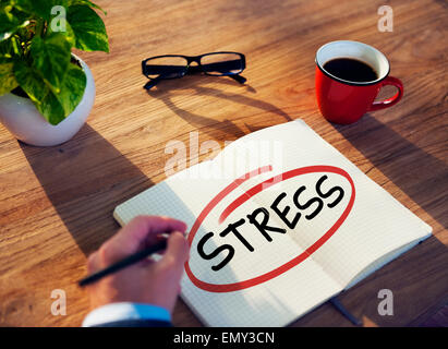 Man with Note Pad and Stress Concept - Stock Photo