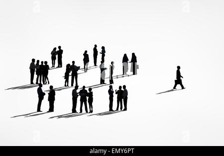 Lone Silhouettes Of A Business Man Walking Away From The Group Of Silhouettes Of Business People. - Stock Photo