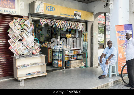 men outside a small convenience store in kuala lumpur malaysia stock photo royalty free image. Black Bedroom Furniture Sets. Home Design Ideas