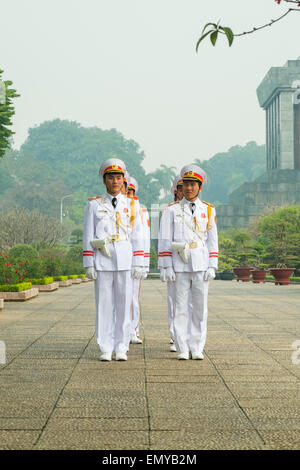 HANOI, VIETNAM - January 27, 2014: Guards on parade at the Ho Chi Minh Mausoleum in Ba Dinh Square in Jaunary 2014. - Stock Photo