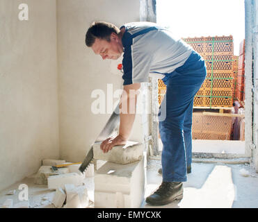 Construction Worker Stone Cutting Work By Cut Off Saw With