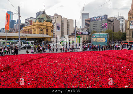 Melbourne, Australia. 24 April 2015. A sea of handmade red poppies in Federation Square ahead of ANZAC Day centenary - Stock Photo