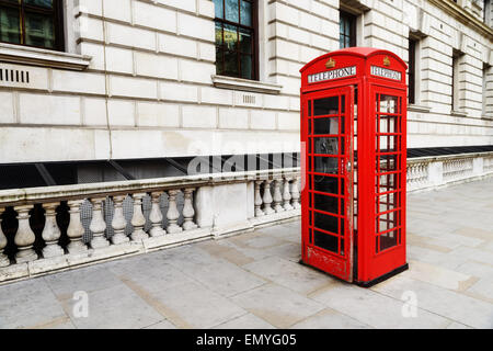 Red telephone near Big Ben, in London, England, the UK. One of the symbols of London city. - Stock Photo