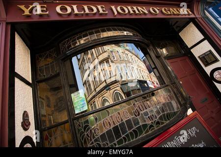 UK, England, Lancashire, Lancaster, Market Street, reflection in Ye Olde John of Gaunt pub window - Stock Photo