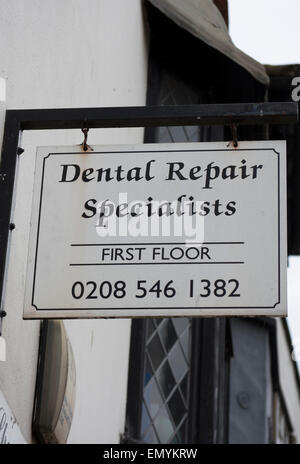 dental repair specialist hanging sign in kingston upon thames, surrey, england - Stock Photo