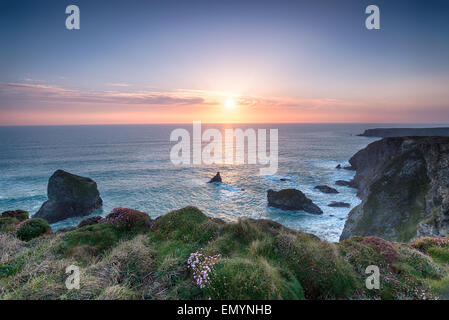 Sunset on the South West Coast path at Pentire Steps between Newquay and Padstow on the north coast of Cornwall - Stock Photo