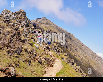 Group of Ramblers descending down the Rhyd Ddu path from Mount Snowdon summit in Snowdonia National Park, Gwynedd, - Stock Photo