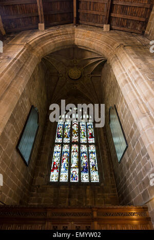 Interior of the 'Cathedral of the Peak', Tideswell, Derbyshire. Window below the tower. - Stock Photo