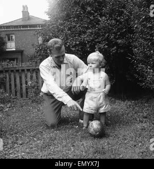 Manchester City footballer Don Revie pictured with his son Duncan in the back garden of the family home. 4th August - Stock Photo
